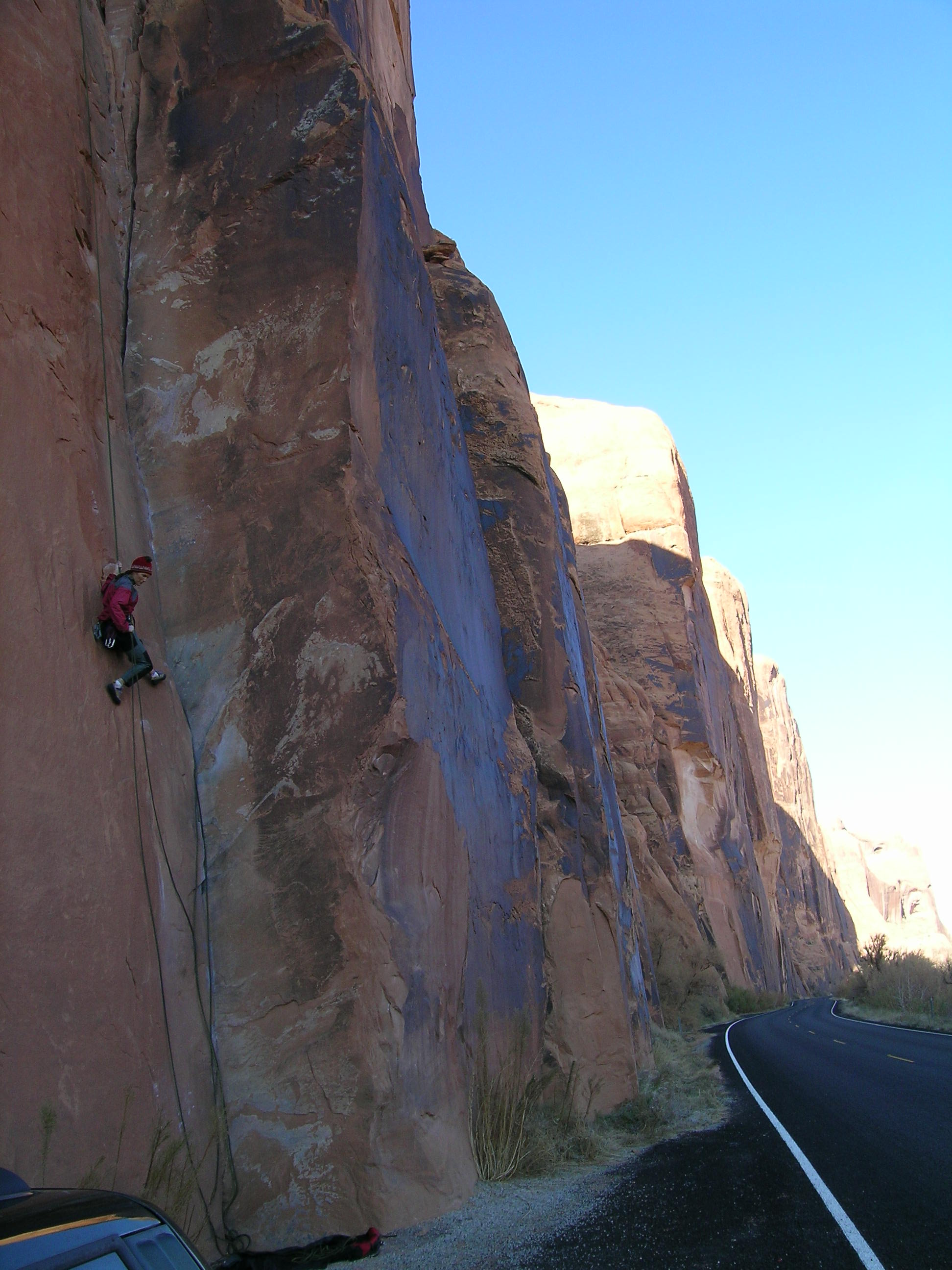"Holly Rapping Off ""30 Seconds Over Potash"" Wall Street crag in Moab"
