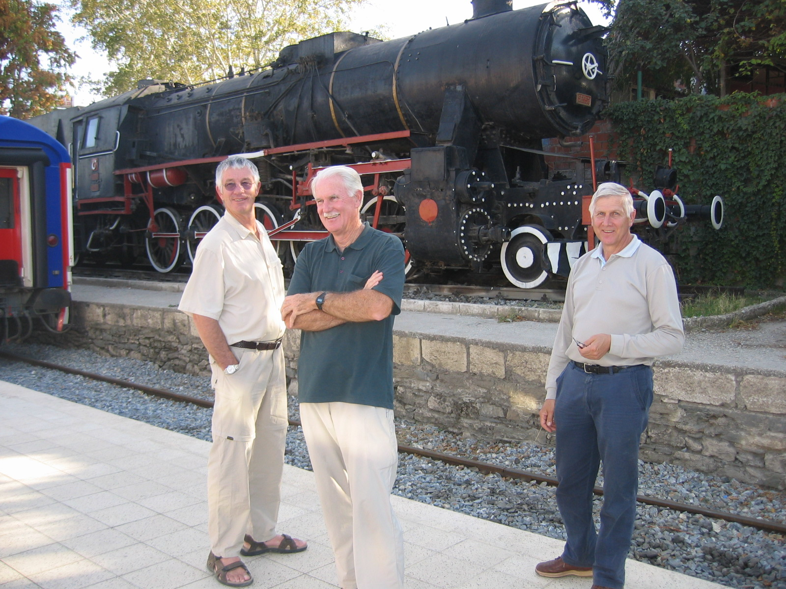 Barry, Robert, and Richard looking handsome in front of an old train